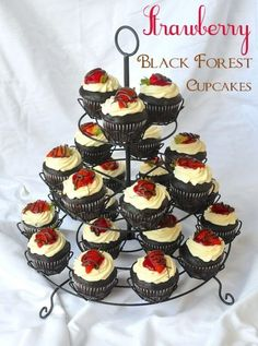 Strawberry Black Forest Cupcakes. A deliciously decadent combination of rich chocolate and sweet strawberry flavours topped with whipped cream and more chocolate!