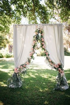 "Wedding Concepts ignited a flower obsession in me by introducing us to the amazing floral designer Heike le Cordeur,"" Gretchen says. ""We were completely in awe of the floral and structural elements that Wedding Concepts and Heike conceptualized and designed using a soft palette of eucalyptus, lavender, blush, and cream. Our curtained ceremony arch was beautifully draped with the most fragrant flowers!"""