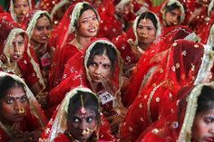 Bejeweled brides attend a mass marriage ceremony at Noida on the outskirts of New Delhi, India.