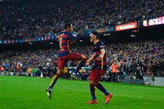 Neymar of FC Barcelona celebrates with his teammate Luis Suarez of FC Barcelona after scoring his team's third goal during the La Liga match between FC Barcelona and Villarreal CF at Camp Nou on November 8, 2015 in Barcelona, Catalonia.