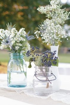 Baby's breath in blue tinted mason jars or vases. **Simple elegance** used as centerpieces for an indoor or outdoor wedding Wildflower Centerpieces, Wedding Centerpieces Mason Jars, Wedding Decorations, Table Decorations, Lavender Centerpieces, Centerpiece Ideas, Table Centerpieces, Flower Decorations, Wedding Table