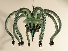 Octopus chandelier, again. Note the tiny pointy halogen bulbs at end of each tentacle.
