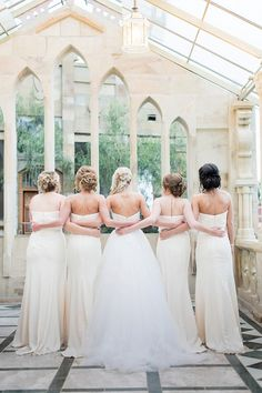 Long white bridesmaid dresses | Romantic Rose Gold Wedding | SouthBound Bride | http://www.southboundbride.com/romantic-rose-gold-wedding-at-shepstone-gardens-by-jack-and-jane | Credit: Jack and Jane Photography