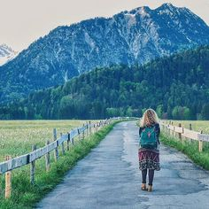 Moments to remember Oberstdorf in Germany, Alp mountains, boho green backpack