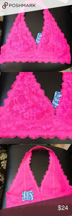 Free People halter lace bralette in hot pink Free People lace halter bralette in hot pink. Size small. Hook and eye closure on back. Sexy lace detail throughout. Beautiful layered under an off the shoulder top. No paypal or trades. Free People Intimates & Sleepwear