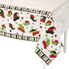 "Elf Plastic Table Cover - Tableware & Table Covers by Seasons Greetings. $8.94. Covered in Red and Green Elf Hats. Cute and Adorable Elf Party Table Cover. Made of Plastic. Pair it with our Plush Hanging Elves!!. Plastic Table Cover. Measures 54"" x 108""   Perfect for your Christmas and Holiday Parties!  Easy to clean up spills."