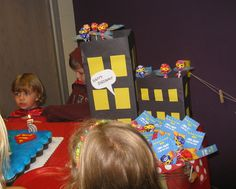 Building decorations were created with contruction paper on cardboard boxes.