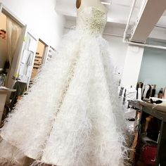 Beaded feather and pearl gown being worked on in the studio today for one of my favorite Neiman Marcus clients. I love this dress! It's so romantic.