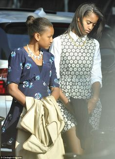Fashion forward: Sasha and Malia attend a performance of Riverdance at the Gaiety Theatre in Dublin wearing printed dress and statement necklaces