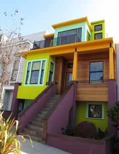 colorful house - I like the mix of the natural wood with the color combo