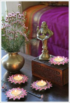 A traditional indian antique brass puja basket is filled for Indoor diwali decoration