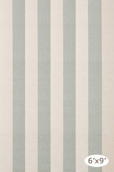 The coastal inspired Yacht Stripe Ocean Woven Cotton Rug blends soothing light blue and cream stripes. The perfect beach house rug.