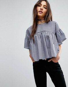 .This is so fun and retro-- Boxy shapes like these look great on my slim shoulders and hips, and I like the gingham.