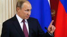 Putin signs domestic violence law