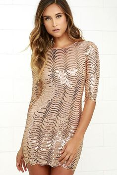 Falling in love is easy, with the Sequin-tessential Gold Sequin Dress! This woven poly dress is covered with beautiful shining gold sequins, for a classy modification. A rounded neckline and three-quarter sleeves top a fitted, darted bodice and bodycon skirt with scalloped, back-stitched hem. Hidden back zipper.