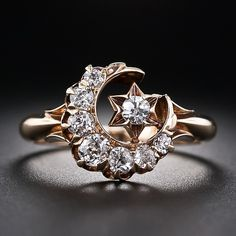 Anel lua crescente e estrela de diamante.