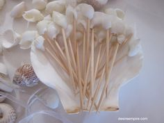 Love this idea of these tooth picks with shells for dinner party hors devours ..simple