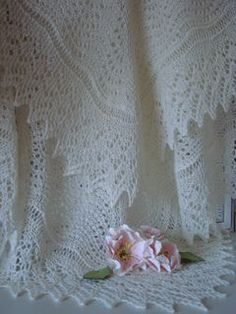 Also available in a circular version as Bubbles. The square is also known as Cute and Cozy Shawl or Cuddly Hour Knitted Shawl or Feather