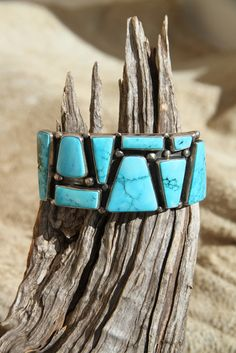 This contemporary chunky turquoise mosaic sterling silver cuff bracelet pops with color. The wide and substantial sterling cuff by Navajo artist Vivian Barbone is oxidized and brushed to give it a modern and dramatic feel.