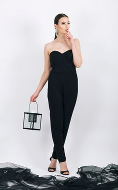 Overalls with heart-shaped top      Hidden zipper fastening at the...