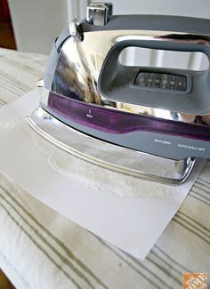 Iron - Clean sticky residue from your iron by ironing over salt spread on a sheet of paper.