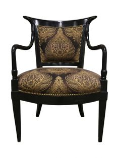 An Ebonized And Upholstered Arm Chair | LH Exchange