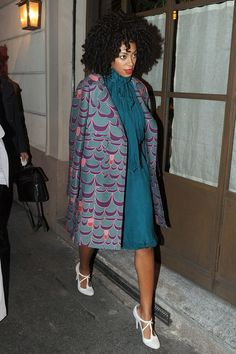 En route to an Alberta Feretti dinner during the Milan shows, making a statement print - and a nonchalent coat-on-shoulder shrug - her own...