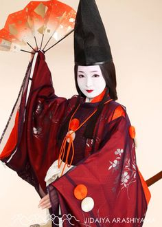A woman dressed as a shirabyoshi dancer at a heian photography experience.