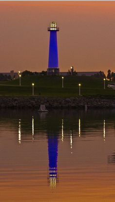 Lighthouse in Long Beach by longfamilytales, via Flickr ~~  This lighthouse is in Rainbow Harbor in Long Beach. During the day, the lighthouse is white. At night it switches from purple to blue to red to green. Note: the haziness in the sky is from the smoke due to the wildfires in California Oct 07.