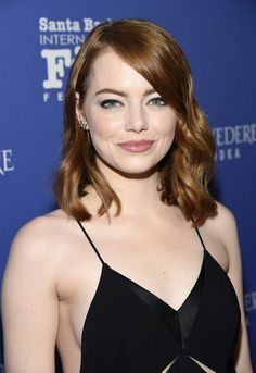 Emma Stone Cropped Jacket - Emma Stone stepped onstage at the Santa Barbara International Film Fest wearing a black cropped jacket over a fringed gown.