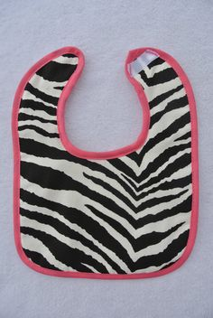 Super TRENDY zebra print bib and matching burp cloth!  So cute and perfect for a baby shower!  Child's name will be embroidered on bib and burp cloth!