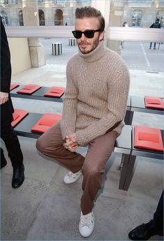 David Beckham embraces brown hues as he sports a turtleneck sweater for Louis Vuitton's fall-winter 2017 men's show.