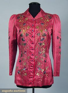 SCHIAPARELLI EVENING JACKET, WINTER 1939    Shocking pink silk satin w/ pale lavender, black & green vertical stripe, front & sleeves embroidered in silk & colored metallic thread in trompe l'oeil morning glory design, 12 pink plastic & blue metal buttons, pink China silk lining,