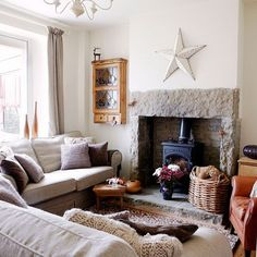 Looking for country living room decorating ideas? Take a look at this neutral living room with a feature wall from Country Homes & Interiors for inspiration. For more living room ideas, such living room feature wall ideas, visit our living room galleries Cottage Living Rooms, Home Living Room, Living Room Designs, Cottage House, Barn Living, Cozy Living, English Living Rooms, Corner Sofa Living Room, House Rooms