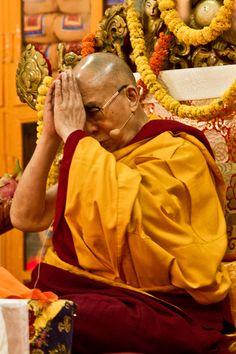 His Holiness the14th Dalai Lama teaching at his temple