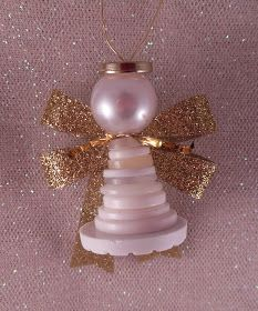 To go with the Baby Jesus ornament I came up with these Button Angels for my students to make this year... They are really very simple: ...