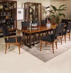 "Century Milan Satin Walnut Dining Table 88""w x 42'w c 30.25"" h Apron Height: 28"" Maximum extension: 132"" with two 22"" aproned leaves"