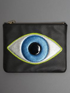 The perfect clutch for those who wish to keep their accessories on the more classic/minimal side. This is a reinvented color-way to one of her best selling styles. Clutch is made from grained faux bla