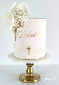 A classy and elegant one tier christening cake featuring a soft pink canvas embellished with the prettiest lace detailing, sugar flowers and golden pearls. www.facebook.com/cakingitup