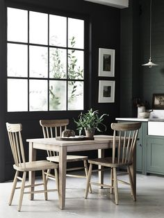 Suffolk kitchen hand-painted in Cactus. Walls painted in Cactus by Neptune. Malvern oak dining table and Wardley oak chairs. We ♥ green interiors.