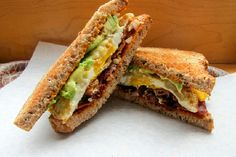 Grilled cheddar, bacon, and avocado sandwiches.  Oh, the fatty goodness.