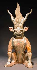 An ancient Chinese painted-terracotta tomb guardian; tomb guardians are usually pairs, one being an amalgamation of animals, the other human and animal; this one has a feline face and body, the legs and hooves of a horse and antlers.  (The Barakat Gallery)
