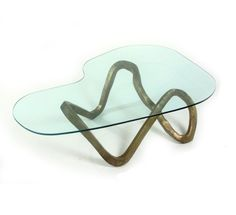Description Coffee table Hand forged bronze base with Japanese patina finish, glass top. design by Working Hands Factory  Dimensions in cm...