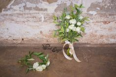 Fresh flower crown and matching bridal bouquet - rustic style with olive leaves, rosemary and white rununculus flowers.