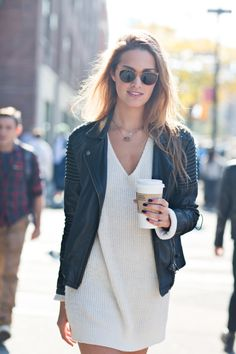 try a sweater dress, moto jacket, and layered necklaces with round frame sunglasses