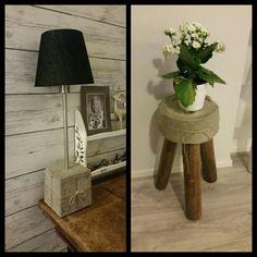 Betonista valettu valaisin ja pieni tuoli