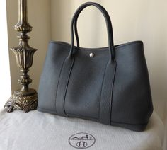 Hermés Garden Party PM in Slate Negonda > http://www.npnbags.co.uk/naughtipidginsnestshop/prod_3817282-Herms-Garden-Party-PM-in-Slate-Negonda-As-New.html