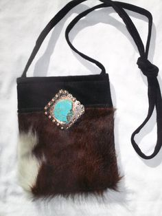 Items similar to Black and White cowhide cross body bag w  silver concho  and turquoise on Etsy aa4ac11cd03e6