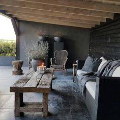 covered patio with dark slate flooring, reclaimed wood coffee table, black sofa . covered patio with dark slate flooring, reclaimed wood coffee table, black sofa with white cushions Decor, Patio Design, Slate Flooring, Furniture, Rustic Patio, Black Sofa, Coffee Table Wood, Modern Farmhouse Coffee Table, Patio Furniture