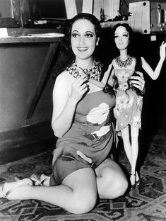 Dorothy Lamour clasping a little replica of herself circa 1939.